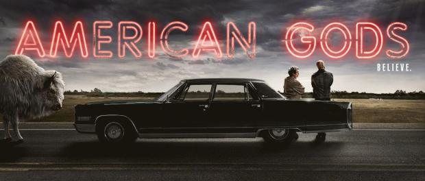 American Gods poster, men leaning on car with buffalo blocking the road.