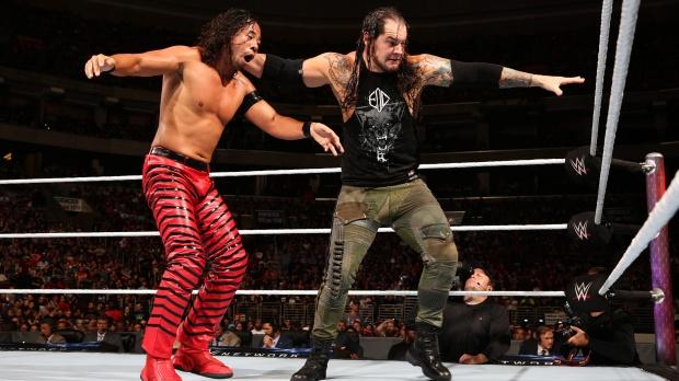 Corbin drive Nakamura into the turnbuckle