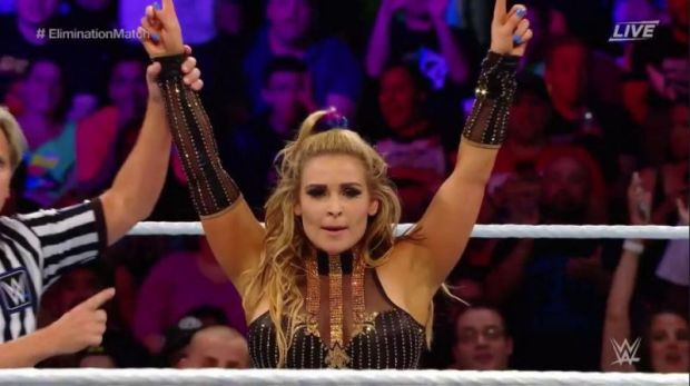 Natalya's arms raised by the referee in victory