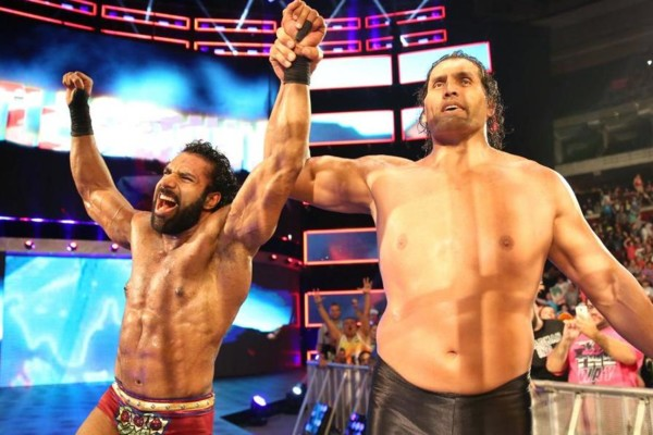 Khali raised Mahal's arm in victory