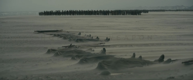 Soldiers buries in shallow grave on the beach in Dunkirk