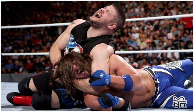 Kevin Owens had AJ Styles in a headlock