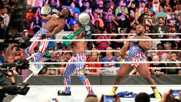 The New Day celebrating with their title belts