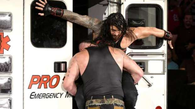 Strowman spears Reigns into the back of the ambulance