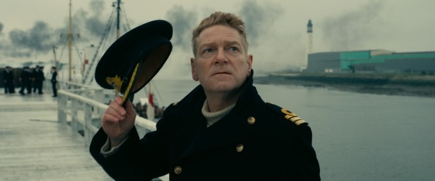 Kenneth Branagh as an officer in Dunkirk looks to the sky for enemy aircraft