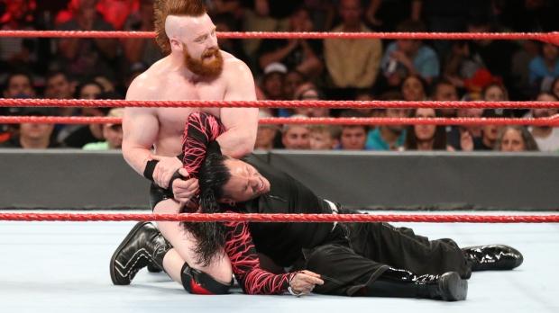 Sheamus has Jeff Hardy in an arm bar