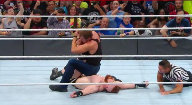 Ambrose puts Shaemus in an ankle lock