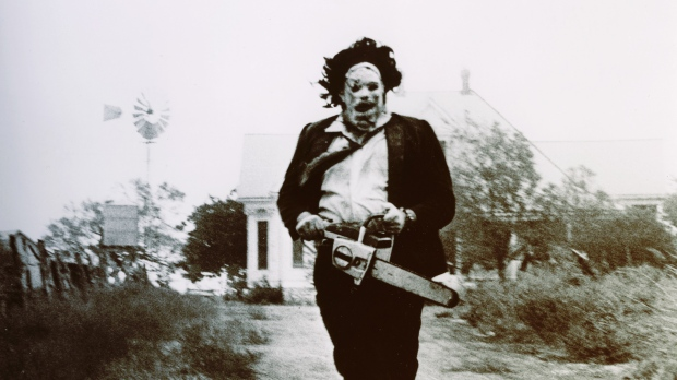 Leatherface standing with chain saw