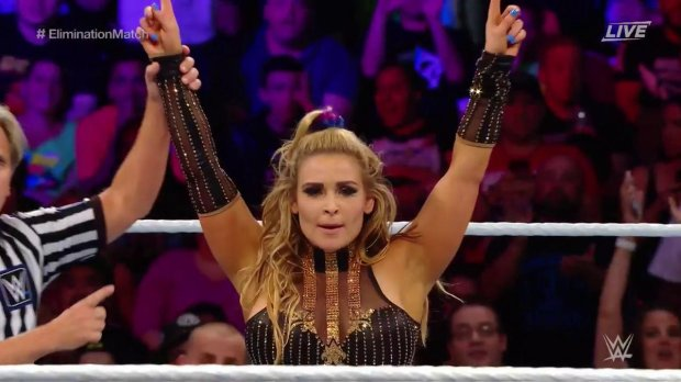 Natalya raises her arms in victory