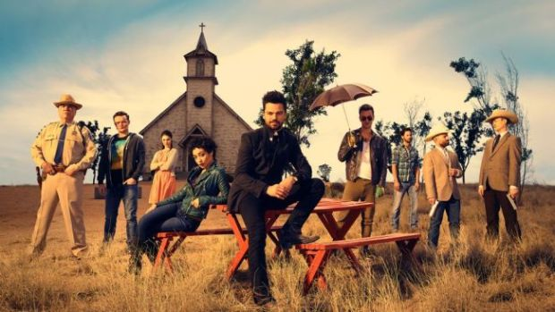 Preacher cast photo in front of church
