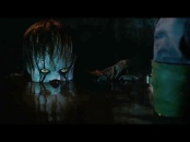 Pennywise surfacing from the water in the flooded basement