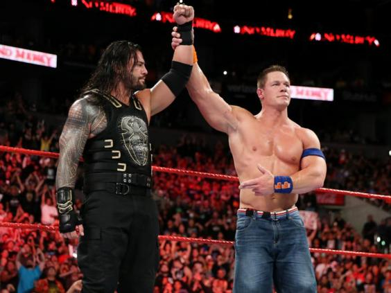 Cena raises Reigns' arm in victory