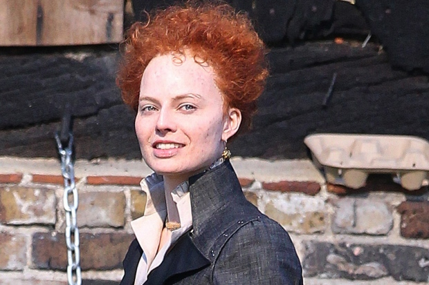 Margot Robbie with red hair in character as Queen Elizabeth