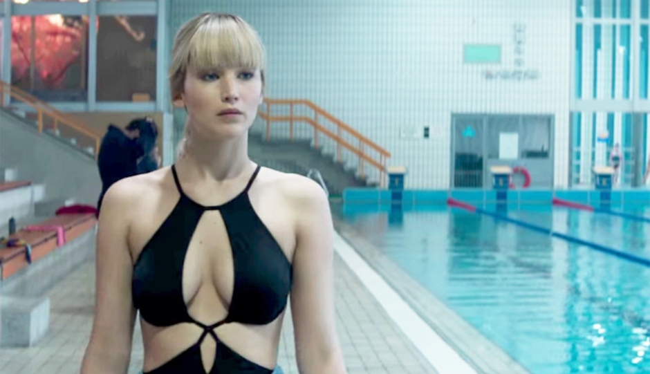 Jennifer Lawrence standing next to a pool in a swimsuit