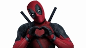 Deadpool making a heart shape with his hands