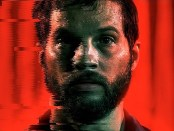 Portrait of Grey Trace, the left side of his face is glitching