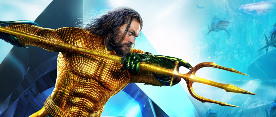 Aquaman in his original costume poised with his trident, ready to strike.