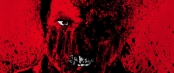 Red splatter art that resembles a sinister face