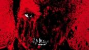 Red splatter art that resembles a sinister face