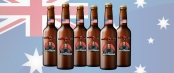 Six bottles of beer labelled with Miscast and Watchman logos in front of the Australian Flag