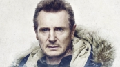 Liam Neeson as Nels Coxman staring intently