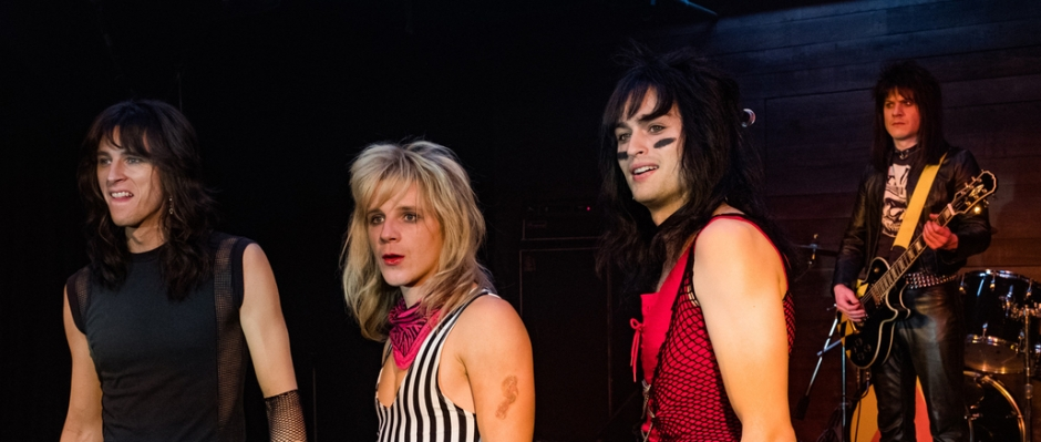 The characters of The Dirt movie, Tommy Lee, Vince Neil, Nikki Six and Mick Mars on stage.