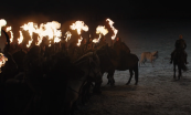 The Dothraki in formation on horseback with flaming weapons