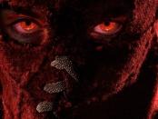 Brandon Breyers in his superhero mask with glowing red eyes.