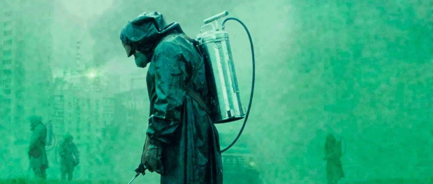 Workers in full radiation suits spraying chemicals on the streets of Pripyat