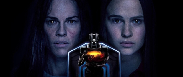 Hillary Swank and Clare Rugaards faces with the robot mother standing in the foreground holding a baby.