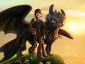 Toothless the dragon and Hiccup standing on top of a mountain