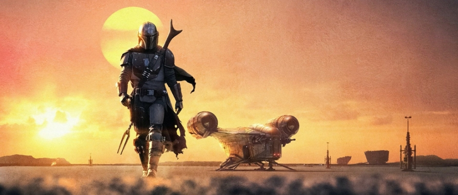 The Mandalorian walking in front of a desert sunset with his ship in the background