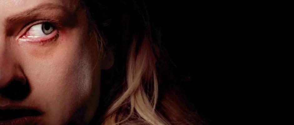 Cecelia in the dark looking over her shoulder, afraid.